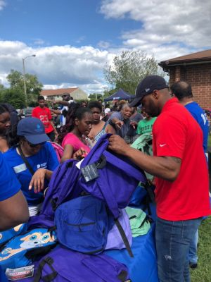 Backpack's Filled with School Supplies Distributed to St. Luke Apartment Residents